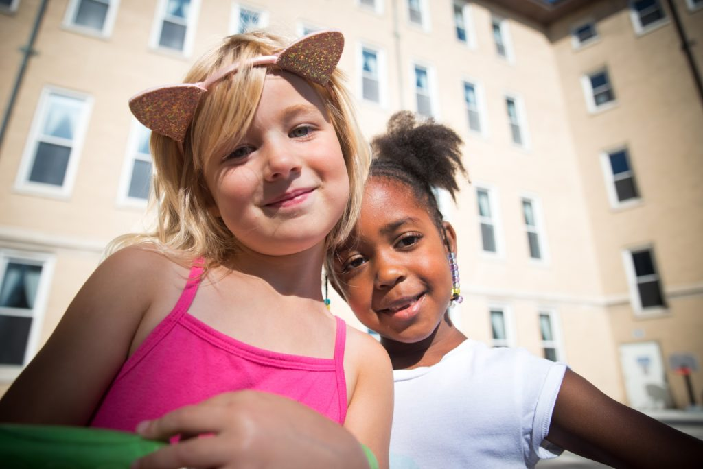 Girl with headband with cat ears and friend.